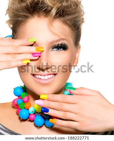 Manicure. Colorful Nails. Beauty Girl with Colorful Makeup, Nail polish and Accessories. Colourful Studio Shot of Funny Woman. Vivid Colors. Bright Nail polish and fashion  - stock photo