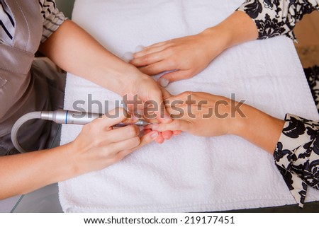 manicure girl in a beauty salon