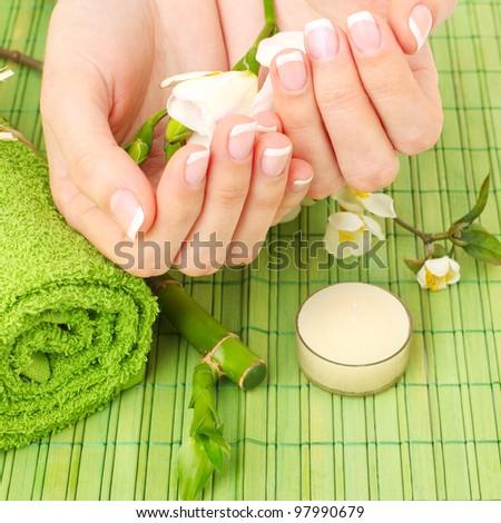Manicure - hands spa, beauty salon - stock photo