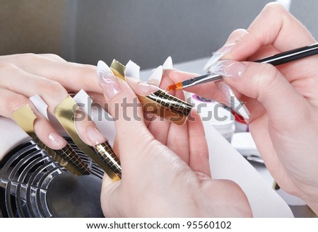 Manicure. Master make nail extension - stock photo