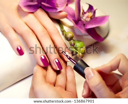 Manicure nail paint pink color - stock photo