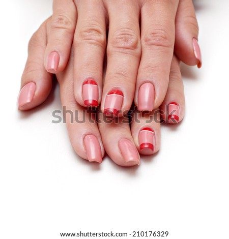 Manicure on short nails covered with red lacquered
