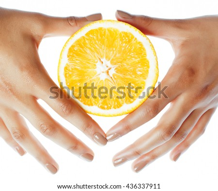 manicure pedicure on afro-american tana skin hands holding orange, healthcare concept - stock photo