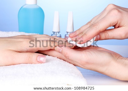 Manicure process in salon - stock photo