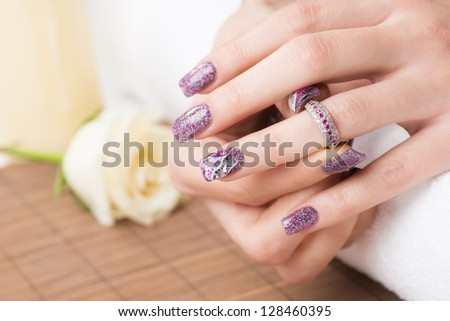 Manicure - Professionally manicured woman fingernails, with engagement ring. - stock photo