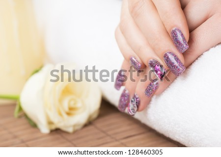 Manicure - Professionally manicured woman fingernails, with engagement ring. Studio shot. - stock photo