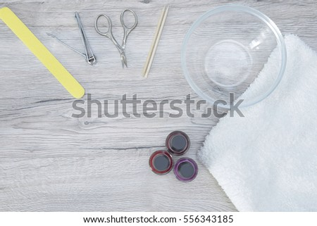 Manicure tools on the wood table
