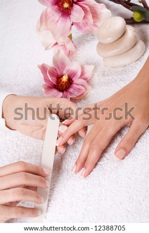 manicure treatment at the wellness center - stock photo
