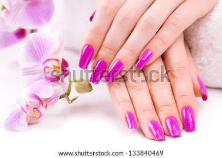 manicure with fragrant orchid and towel - stock photo