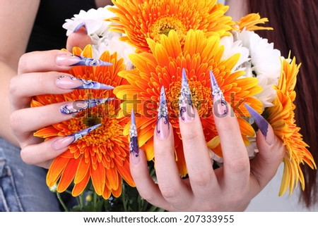 manicured acrylic nails with flowers - stock photo
