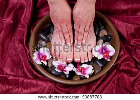 Manicured hands and pedicured feet of a woman