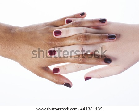 Manicured hands on white isolated, african with caucasian close up - stock photo