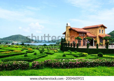Manicured House and Garden. - stock photo