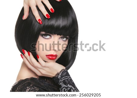 Manicured nails. Beauty girl portrait. Red lips. Back short bob hair. Hairstyle. Professional makeup. - stock photo