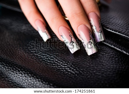 manicures beautiful pattern on nails - stock photo