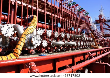 manifold of chemical tanker - stock photo