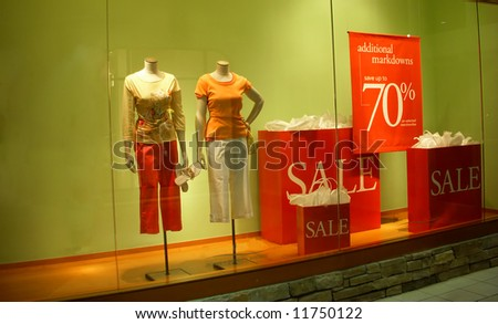 Manikin in a store front - stock photo