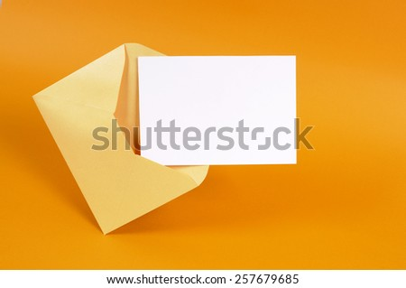 Manila envelope, blank letter, gold background. - stock photo