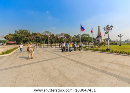 MANILA - FEB 14: Tourists visit Jose Rizal Monument on 14 Feb, 14 in Manila. The monument dedicated for Jose Rezal, he is widely considered the greatest national hero of the Philippines. - stock photo