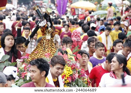 MANILA - JAN. 9: Devotees celebrate the feast of The Black Nazarene on January 9, 2015 in Manila Philippines. The fiesta celebrated with procession of image around the city by million devotees .  - stock photo