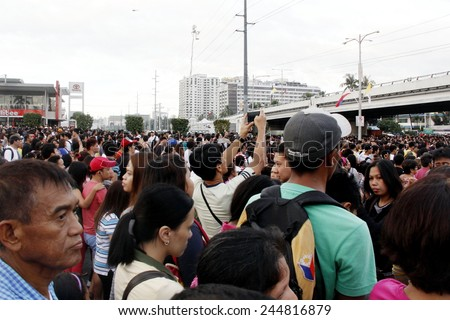 MANILA - JAN 16 2015: Pope Francis as he  arrives in MOA Arena in the Papal visit in Manila on January 16, 2015 The papal motorcades are tightly controlled with the pope waving from a passing vehicle. - stock photo