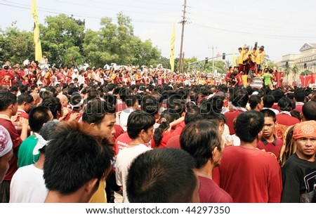 MANILA  JANUARY 9: Devotee celebrate at the feast of  The Black Nazarene on January 9, 2010 in Manila Philippines. The fiesta held annually where devotees walking around Manila barefooted.