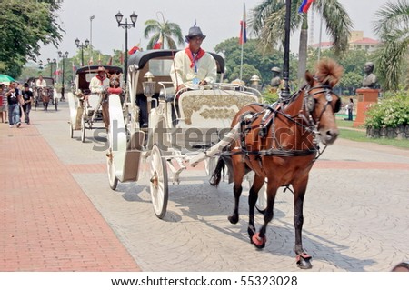 MANILA - JUNE 12: Man prepare the carriage for The Philippine Independence Day on June 12, 2010 in Manila, Philippines. The Independence commemorates the 112th anniversary with parade & exhibitions - stock photo