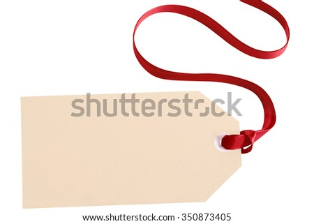 Manila label or gift tag tied with red ribbon isolated on white background