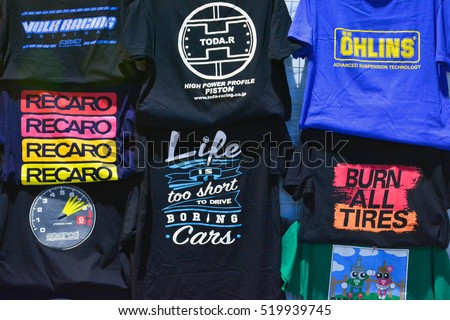 MANILA, PH - NOV. 6: Assorted automotive T-shirts at Manila Auto Salon on November 6, 2016 in Manila, Philippines. Manila Auto Salon is a annual gathering exhibit for automotive aftermarket industry.