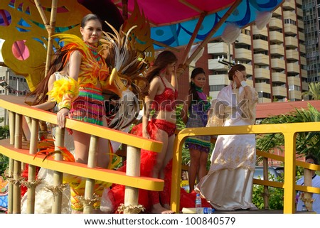 MANILA, PHILIPPINES - APR. 14: beauty contestants in their cultural dresses during Aliwan Fiesta, which is the biggest annual national festival competition on April 14, 2012 in Manila Philippines. - stock photo