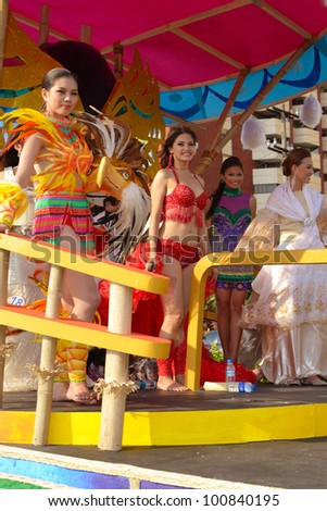 MANILA, PHILIPPINES - APR. 14: beauty contestants in their cultural dresses smiles during Aliwan Fiesta, which is the biggest national festival competition on April 14, 2012 in Manila Philippines. - stock photo