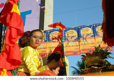 MANILA, PHILIPPINES - APR. 14: parade contestant in her cultural dress pauses during Aliwan Fiesta, which is the biggest annual national festival competition on April 14, 2012 in Manila Philippines. - stock photo