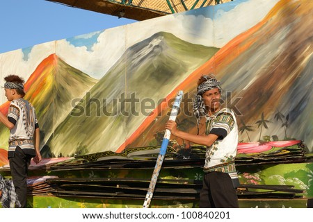 MANILA, PHILIPPINES - APR. 14: performer getting ready their props during Aliwan Fiesta, which is the biggest annual national festival competition on April 14, 2012 in Manila Philippines. - stock photo