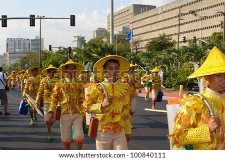 MANILA, PHILIPPINES - APR. 14: street dancers enjoying parade during Aliwan Fiesta, which is the biggest annual national festival competition on April 14, 2012 in Manila Philippines. - stock photo