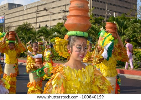 MANILA, PHILIPPINES - APR. 14: street dancers in their cultural outfit  during Aliwan Fiesta, which is the biggest annual national festival competition on April 14, 2012 in Manila Philippines. - stock photo