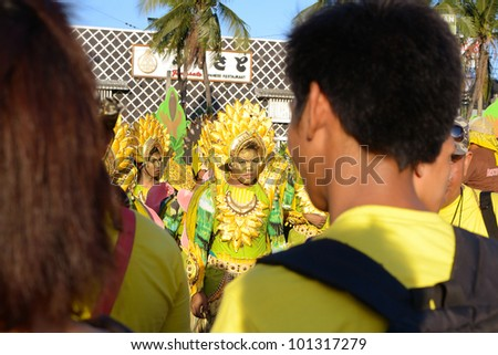 MANILA, PHILIPPINES - APR. 14: street dancers wearing banana costume during Aliwan Fiesta, which is the biggest annual national festival competition on April 14, 2012 in Manila Philippines. - stock photo