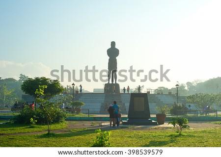 MANILA, PHILIPPINES - APRIL 01, 2012: People at the Statue of the Sentinel of Freedom (statue of Lapu-lapu) in Luneta park, Metro Manila, Philippines  - stock photo