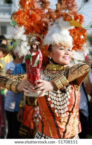 MANILA, PHILIPPINES - APRIL 24: Street performer showcase Filipino culture & tradition in the Aliwan Fiesta on April 24, 2010 in Manila. Aliwan Fiesta celebrated annually with street dance. - stock photo