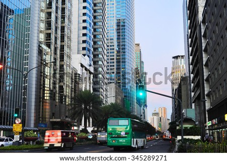 MANILA, PHILIPPINES - APRIL 02, 2012: Traffic on a road in  Makati city in Metro Manila, Philippines. Makati - business center and one of the 17 cities that make up Metro Manila. - stock photo