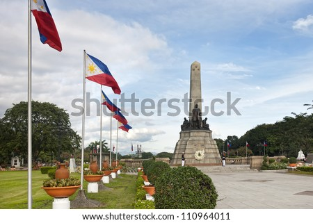 MANILA, PHILIPPINES - AUGUST 7:  Members of the Philippine Navy stand on guard during a ceremony in front of Rizal's monument in Luneta on August 7, 2011. - stock photo