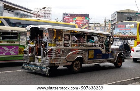 Manila, Philippines - Dec 20, 2015.  Jeepney carrying passengers on street at Chinatown in Manila, Philippines.