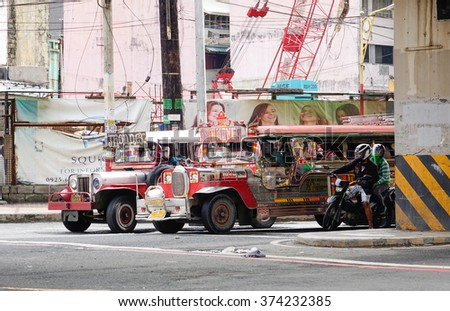 Manila, Philippines - Dec 20, 2015. Jeepneys parking on the street in Manila, Philippines. Jeepneys are the most popular means of public transportation in the Philippines.