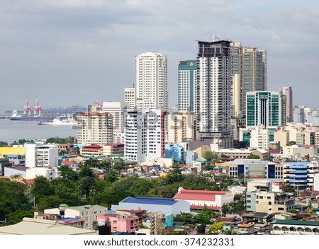 Manila, Philippines - Dec 20, 2015. Many tall buildings located in Manila downtown, Philippines. Manila is the second most populous city in the Philippines with a population of 1,652,171. - stock photo