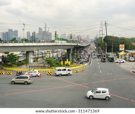 MANILA, PHILIPPINES - FEB 14, 2015. Traffic on the street in Makati city, Manila. Makati is the financial center of the Philippines with the highest concentration of multinational corporations. - stock photo