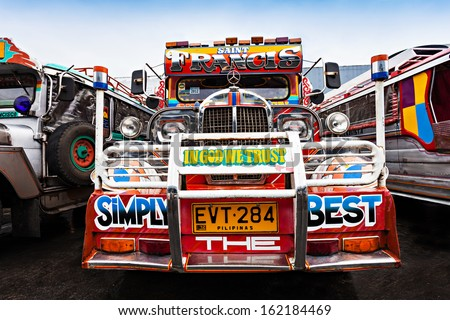 MANILA, PHILIPPINES - FEBRUARY 25: Jeepney on the bus station on February, 25, 2013, Manila, Philippines. Jeepney is a most popular public transport on Philippines.
