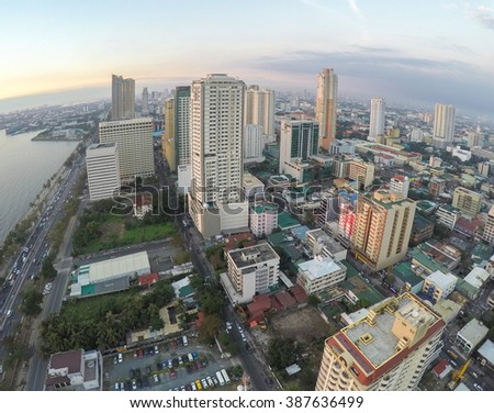 Manila, Philippines - January 19, 2015: Roxas Boulevard at evening, high-rise buildings skyscrapers in Manila, Philippines . - stock photo
