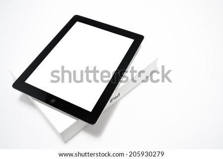 Manila,Philippines - July 17, 2014: Apple Ipad 4th generation with  its retail box.The fourth generation iPad maintained the Retina Display which was  first released on 2012. November 2, 2012. - stock photo