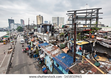 MANILA, PHILIPPINES - MARCH 18: Slum region on March, 18, 2013, Manila, Philippines. Manila is a Philippines capital with very strong contrasts in standard of living. - stock photo