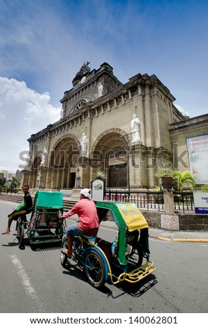 MANILA, PHILIPPINES - MAY 6: Tricycle taxi one of the most popular forms of transportation in Phillipines on May 6,2012 at Manila Cathedral in Intramuros district of Manila , Philippines. - stock photo