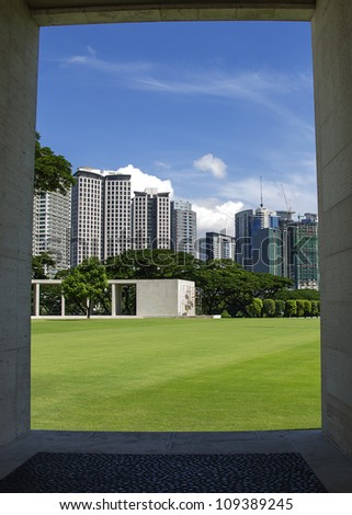 Manila skyline, framed by the monument at the city's American war cemetery. - stock photo